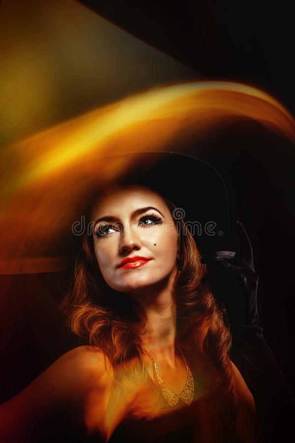 Portrait of attractive witch for Halloween. Portrait of a young attractive girl in a witch costume for Halloween shot using techniques mixed light royalty free stock photo
