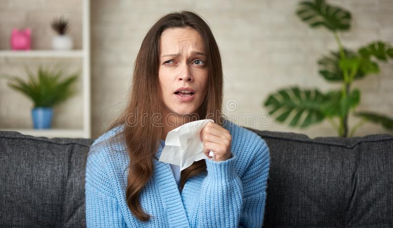 Attractive woman caught cold stock photography