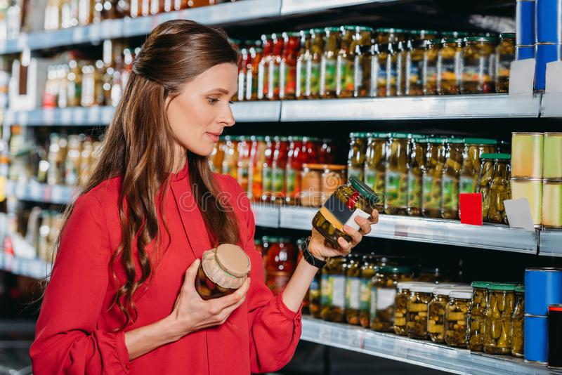 portrait of attractive woman choosing products stock photos