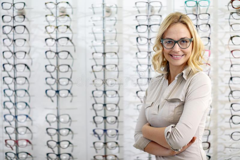 Portrait of woman with eyeglasses in eyewear shop stock images