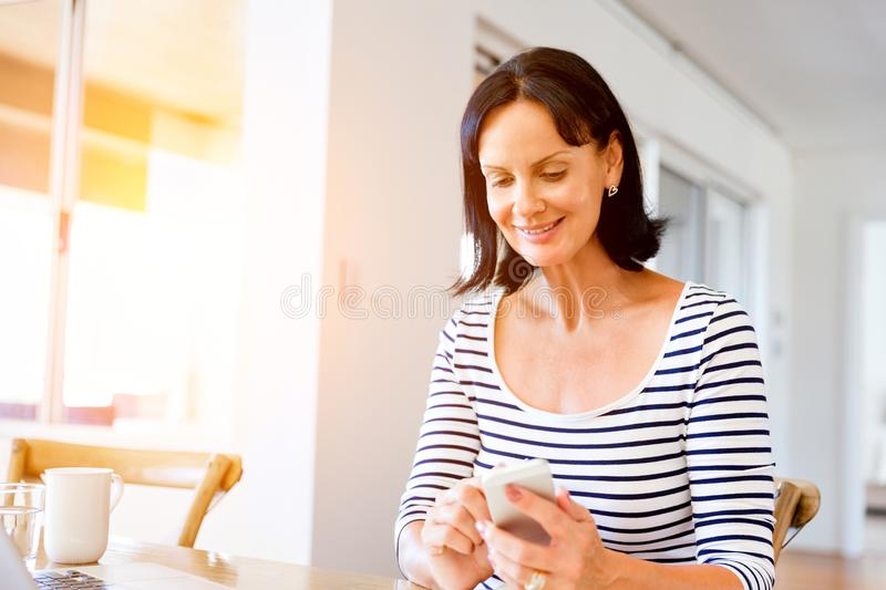 Portrait of attractive woman holding phone royalty free stock image