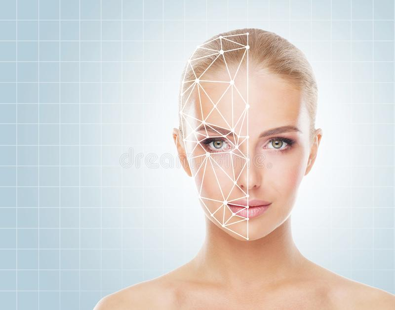 Portrait of attractive woman with a scnanning grid on her face. Face id, security, facial recognition concept. royalty free stock photo
