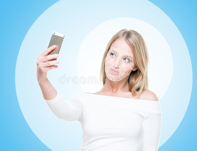 Portrait of attractive woman with a scnanning grid on her face. Face id, security, facial recognition, future technology stock photography