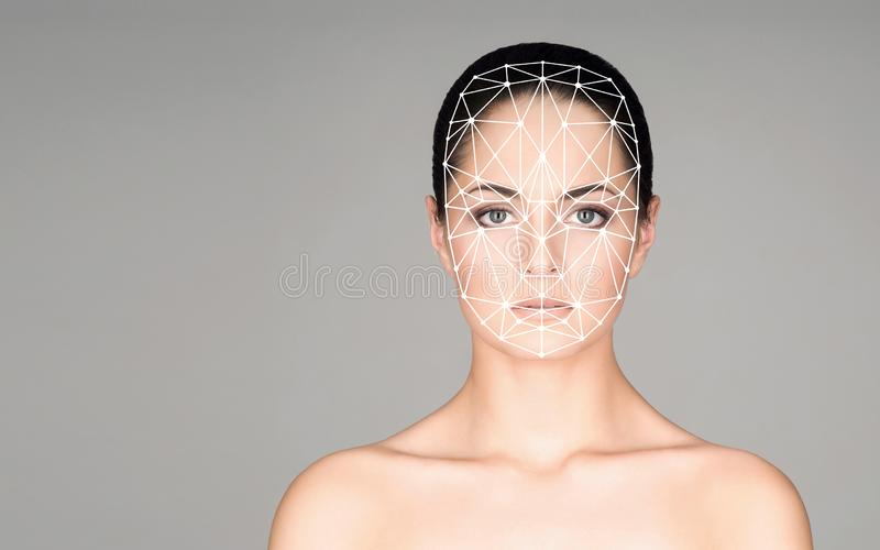 Portrait of attractive woman with a scnanning grid on her face. Face id, security, facial recognition, future technology stock photos