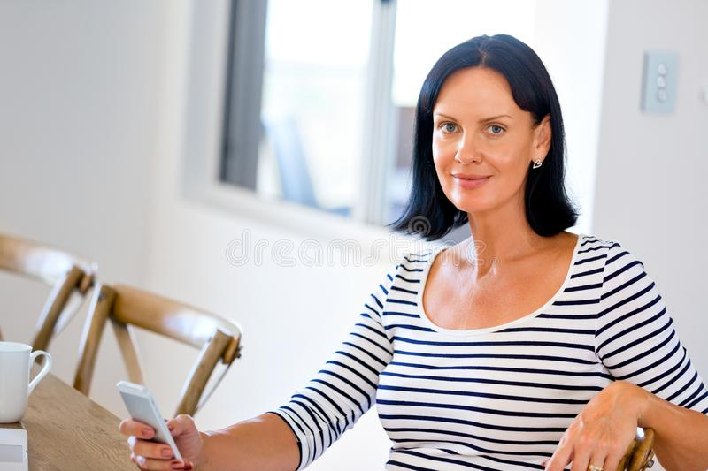 Portrait of attractive woman holding phone stock photos