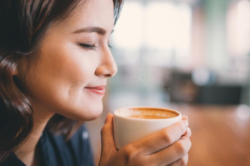 Portrait of attractive young asian woman drinking coffee.  stock photo