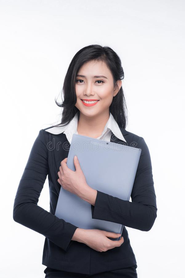 Portrait of an attractive young businesswoman with blue folder, stock images