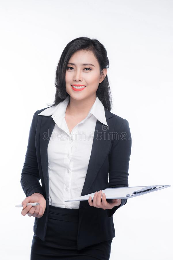 Portrait of an attractive young businesswoman with blue folder, royalty free stock images