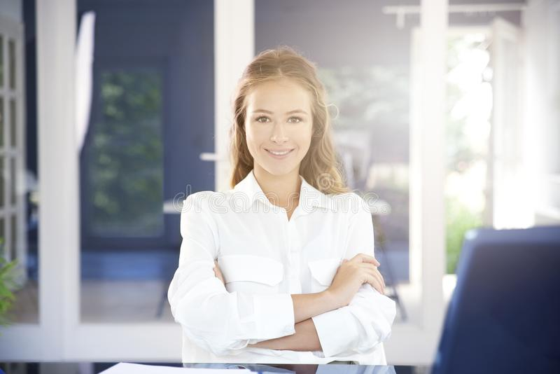 Beautiful young businesswoman portrait while sitting in the office stock photo