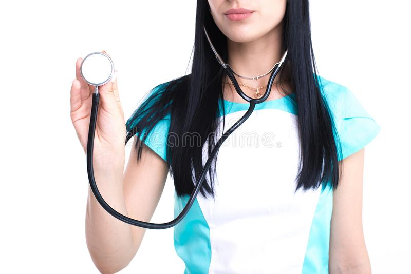 Portrait of an attractive young female doctor in white and blue coat. royalty free stock images