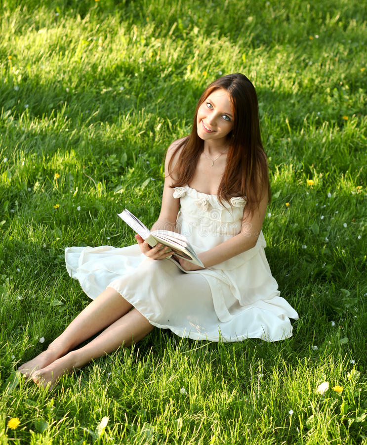 Portrait of attractive young girl reading book royalty free stock images