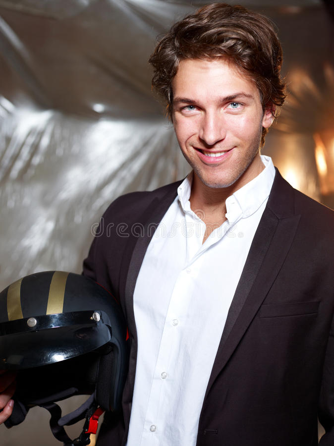 Portrait of an attractive young man with helmet stock photo