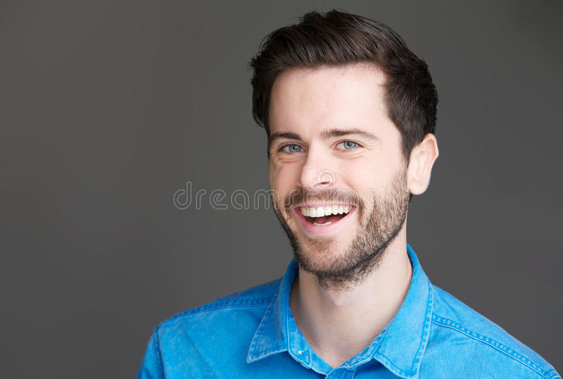 Download Portrait Of An Attractive Young Man Laughing Stock Photo - Image of cheerful, handsome: 33838756