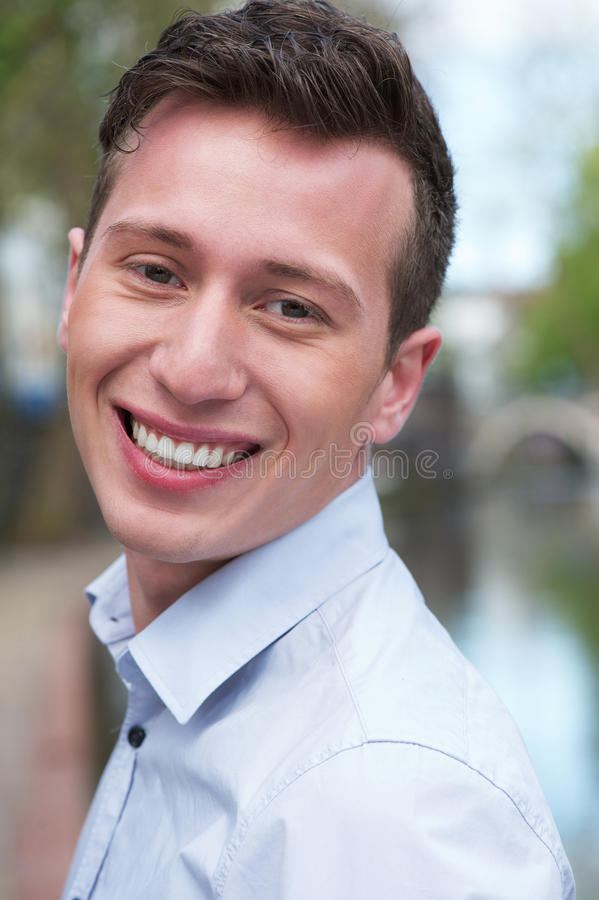 Download Portrait Of An Attractive Young Man Smiling Outdoors Stock Photo - Image: 30988570