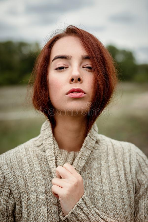 Portrait of attractive young red haired  woman royalty free stock photo