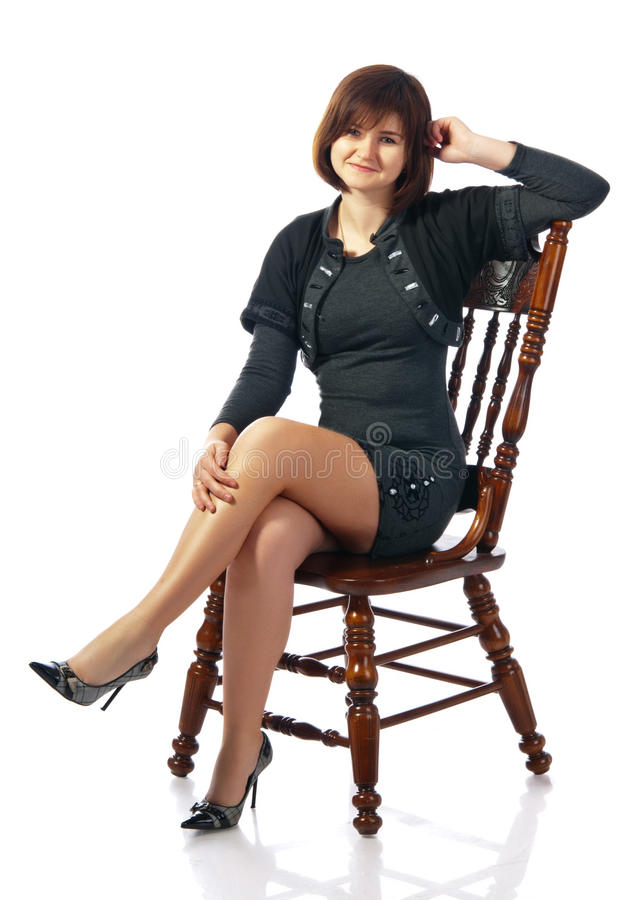 Portrait of attractive young sitting girl stock image