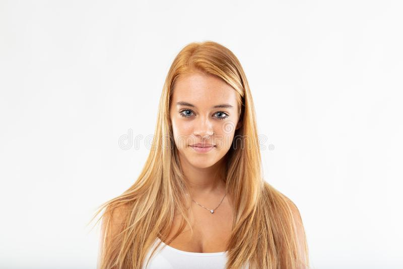 Portrait of an attractive young student with acne. Portrait of an attractive young blond student with age related adolescent acne looking at the camera with a stock photography