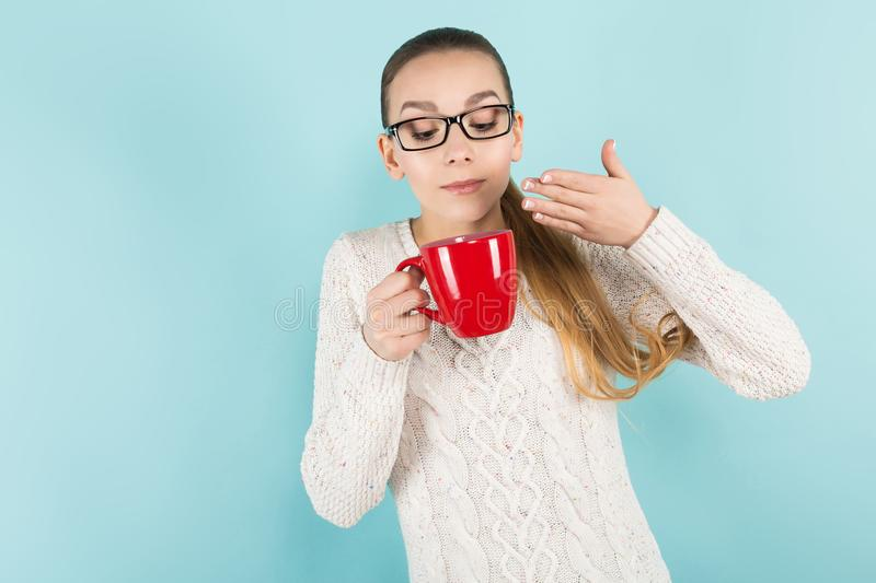 Attractive woman with ponytail and cup stock photo