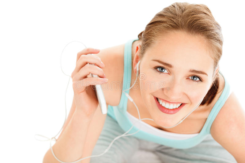 Portrait of attractive young woman listening to music at gym. Portrait of attractive young woman listening music at gym smiling stock photography