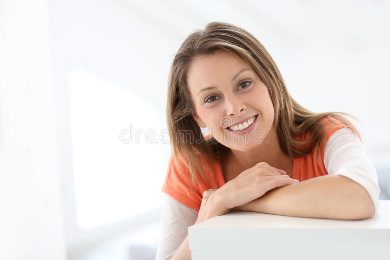 Portrait of attractive young woman on sofa. Portrait of attractive young woman stock image