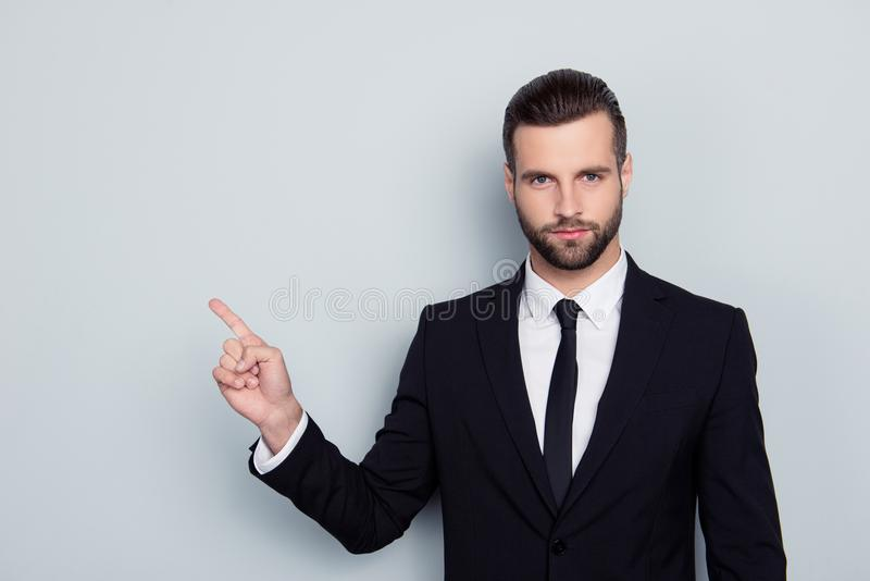 Portrait of authoritative strict manful bossy serious angry confident focused expert assistant wearing white shirt black tie. Pointing on empty blank copy space stock photo