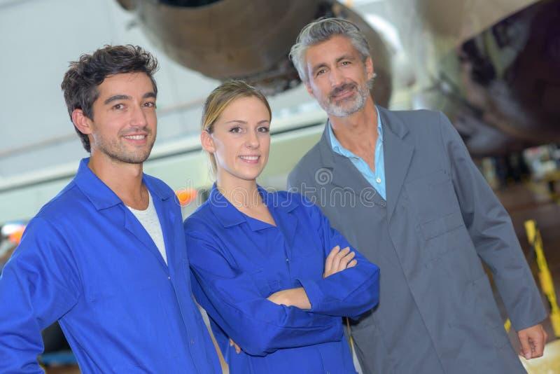 Portrait avionics team posing royalty free stock images