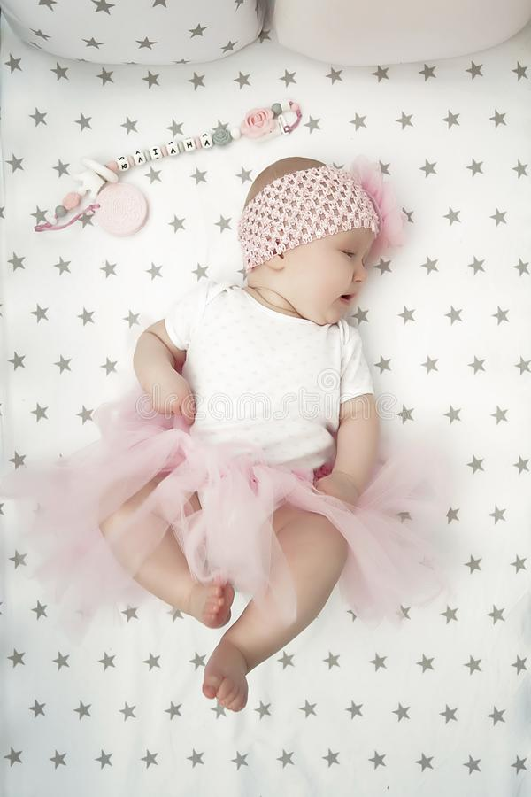 Portrait of baby on the bed in her room. love for children royalty free stock images