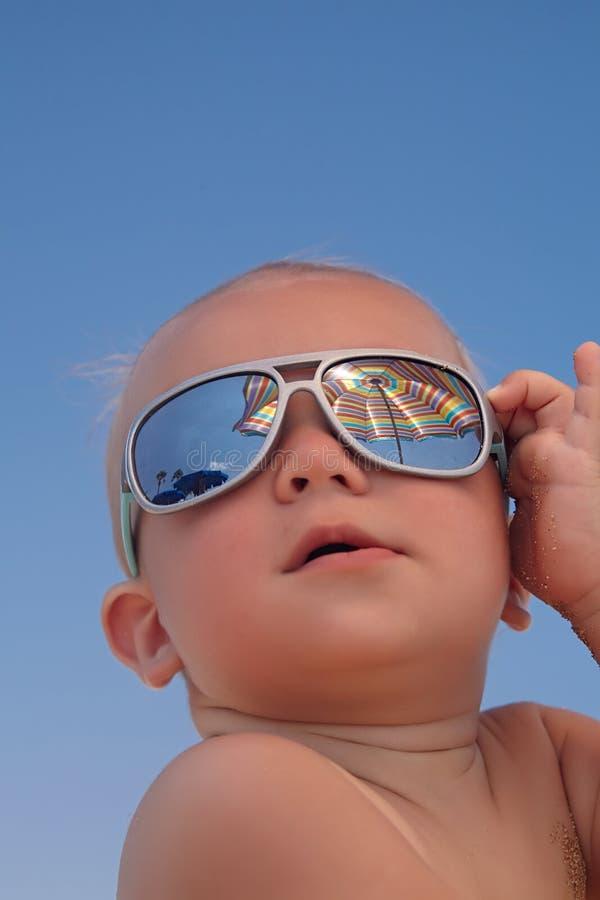 Portrait of baby boy with sunglasses. Portrait of adorable baby boy with sunglasses royalty free stock images