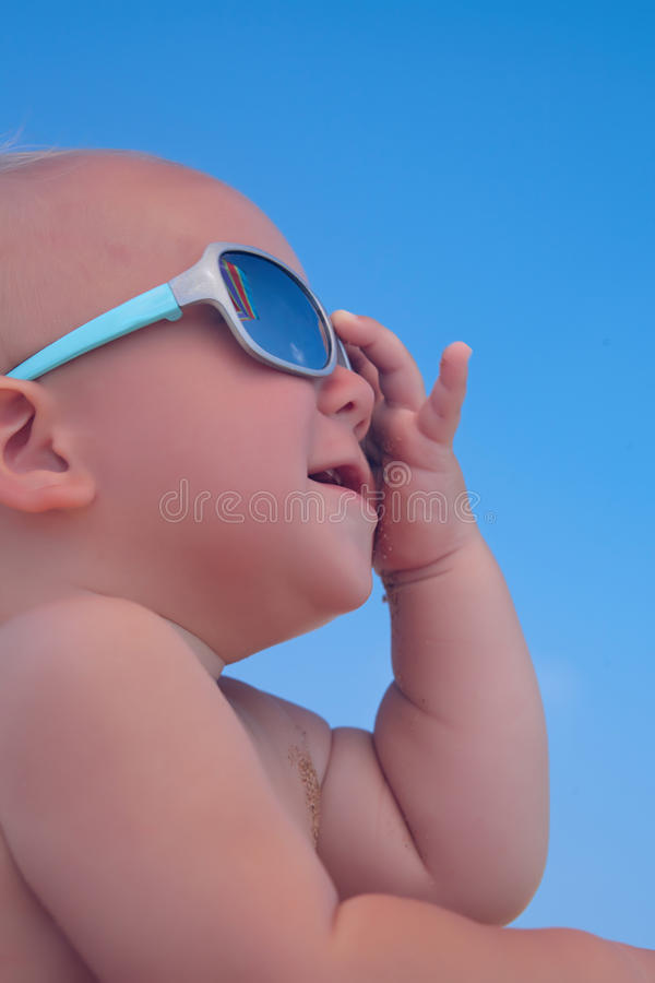 Portrait of baby boy with sunglasses. Portrait of adorable baby boy with sunglasses royalty free stock photography