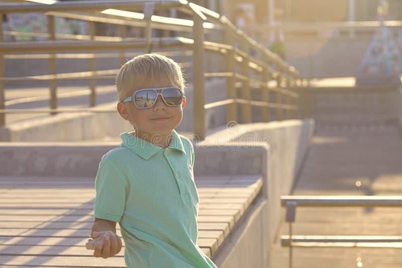 Portrait of baby boy with sunglasses. Portrait of adorable baby boy with sunglasses royalty free stock photos