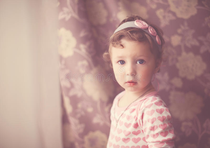 Portrait of a baby girl in vintage style stock photo