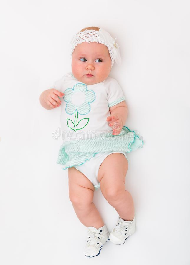 Portrait of a baby girl on a white background stock photo