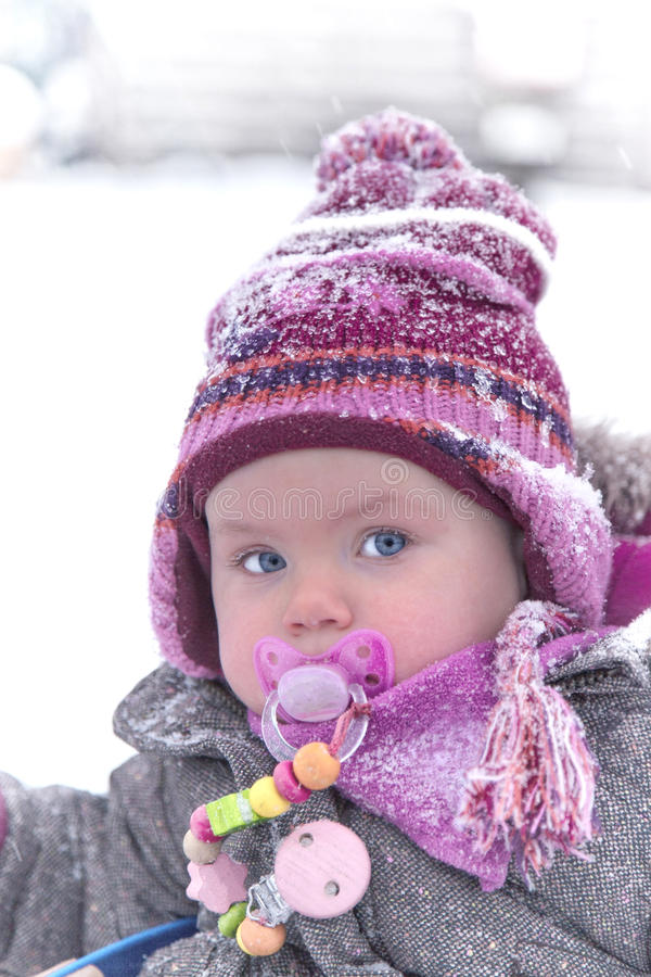 Portrait of a baby girl in winter royalty free stock photo