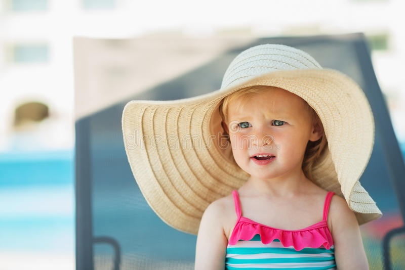 Download Portrait Of Baby In Hat Sitting On Sunbed Royalty Free Stock Images - Image: 25470749