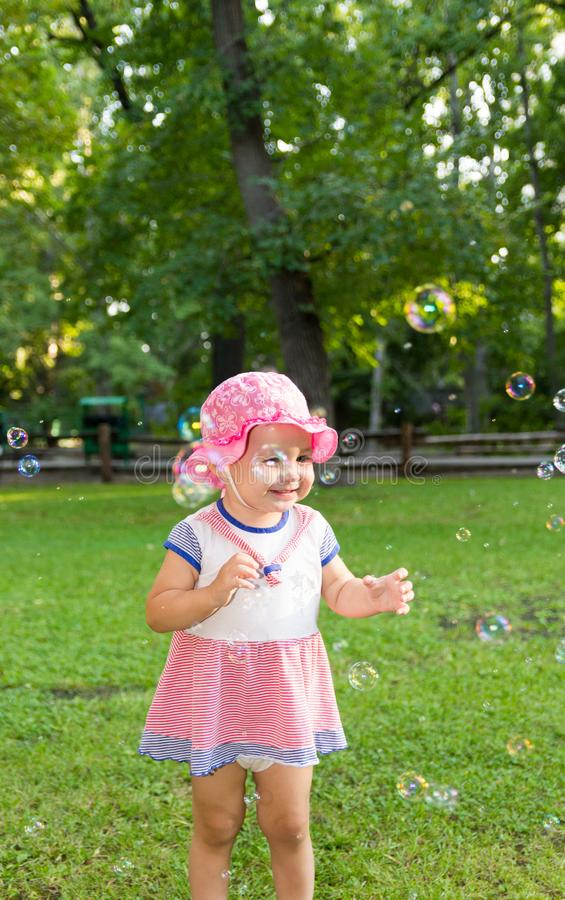 Portrait of a baby and soap bubbles stock photo