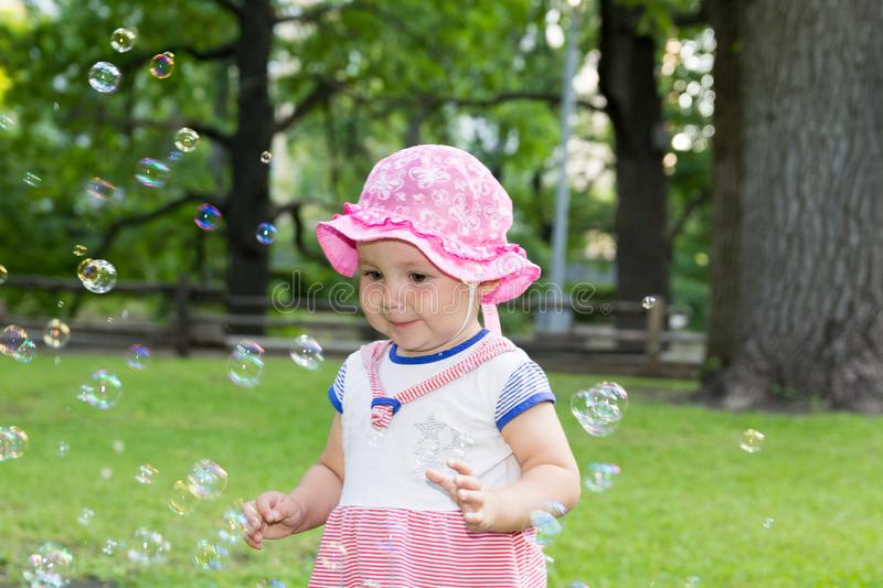 Portrait of a baby and soap bubbles stock image