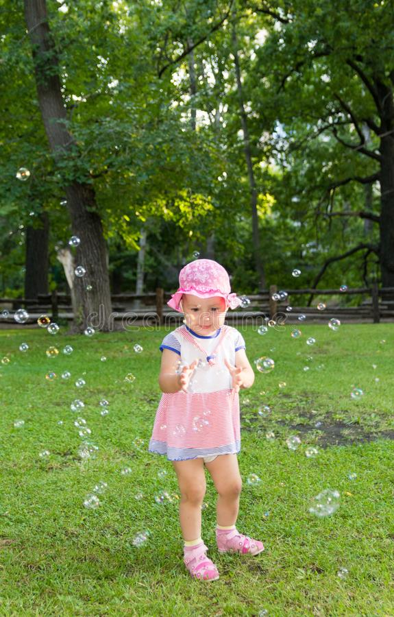 Portrait of a baby and soap bubbles stock images