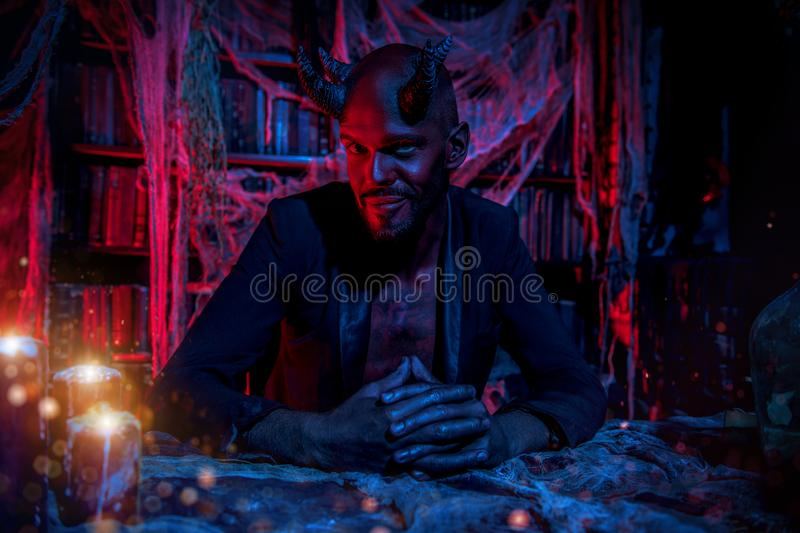 Devil is at home stock photography