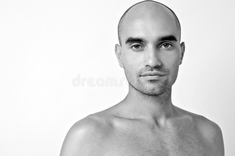 Portrait of a bald man. Bald Caucasian handsome man with topless shoulders. royalty free stock image