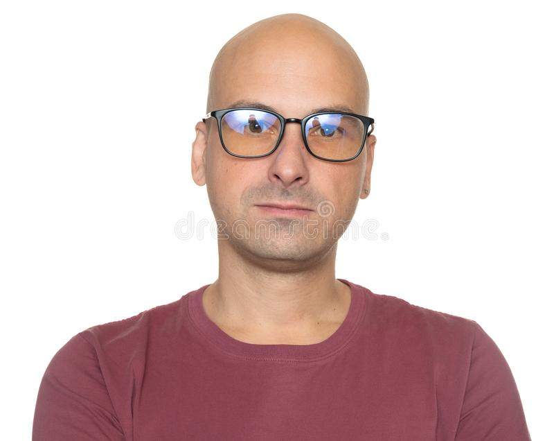 Portrait of a bald man wearing glasses. Isolated royalty free stock images