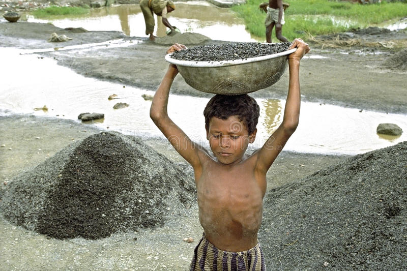 Portrait of Bangladeshi boy working in gravel pit stock images