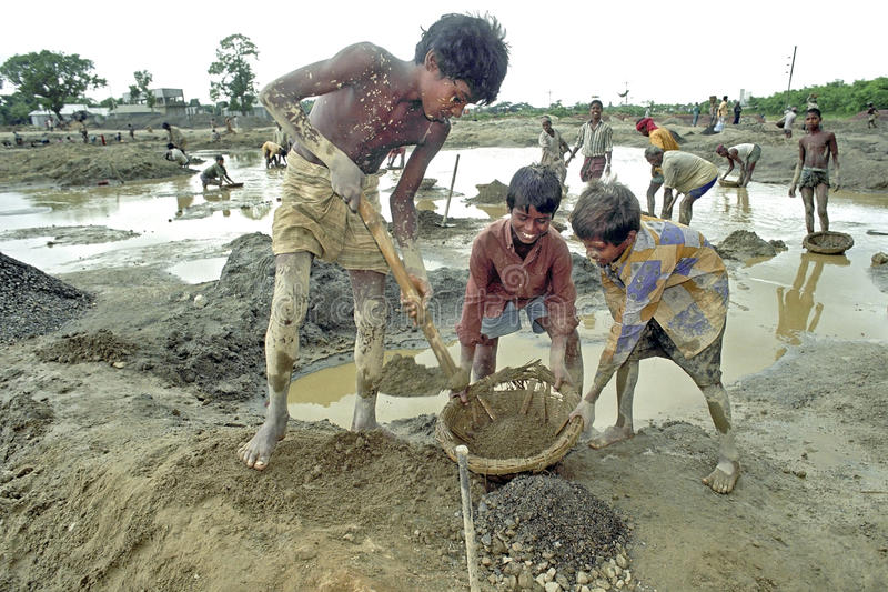 Portrait of Bangladeshi boys working in gravel pit royalty free stock photo