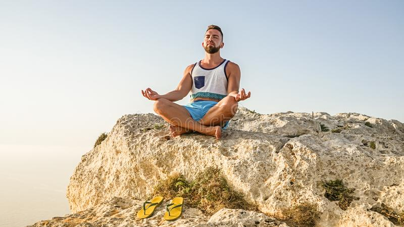 Portrait of bearded adult man making lotus pose royalty free stock image