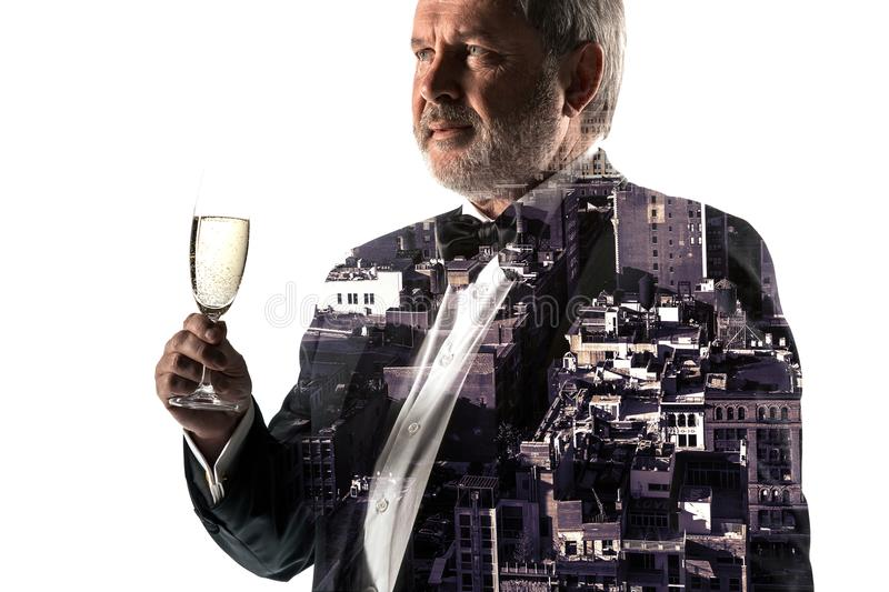 Portrait of bearded businessman. Double exposure city on the background. royalty free stock photo
