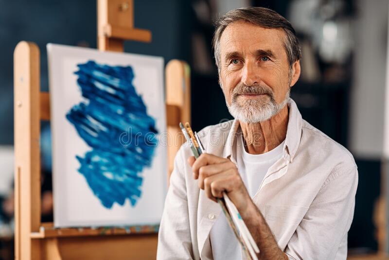 Portrait of bearded painter sitting royalty free stock image