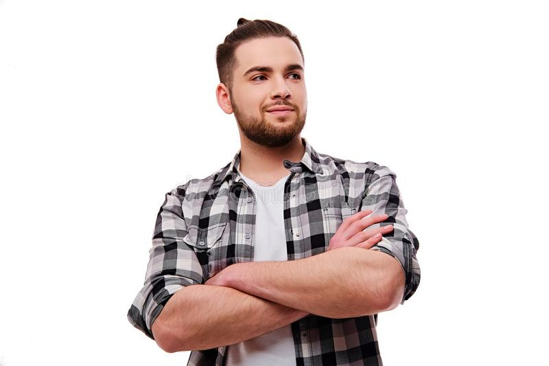 Portrait of bearded, smiling male with crossed arms. stock images