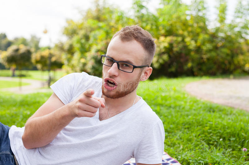 Portrait of bearded young man. Caucasian man smiling happy on sunny summer or spring day outside in park.  royalty free stock photography