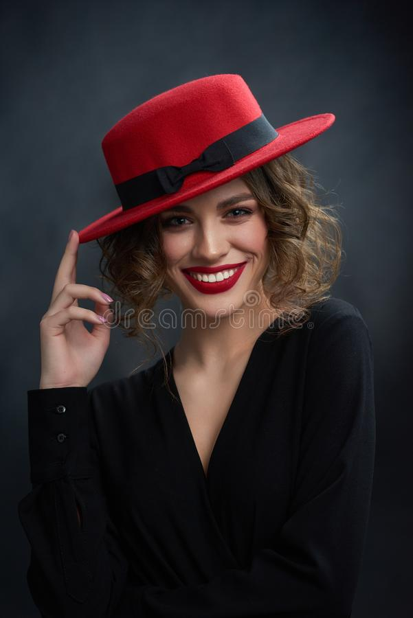 Portrait of wonderful girl touching red hat. royalty free stock photos
