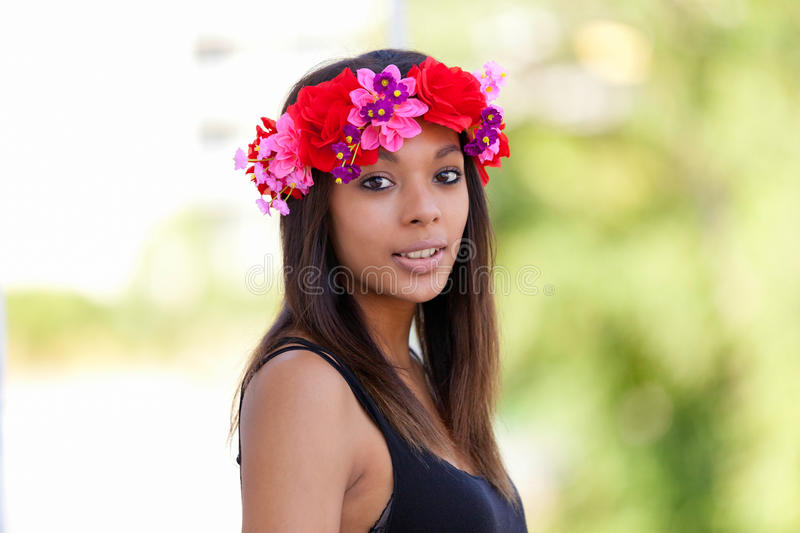 Portrait of a beautiful african young woman outdoors stock photography