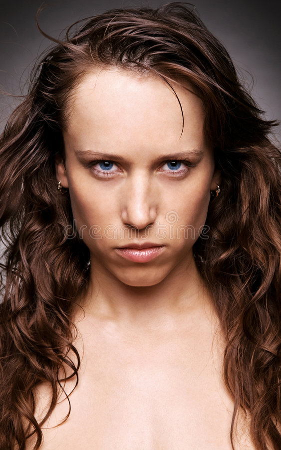 Portrait of beautiful but aggressive woman royalty free stock photo